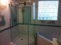 Master Bath with Curved Shower Doors
